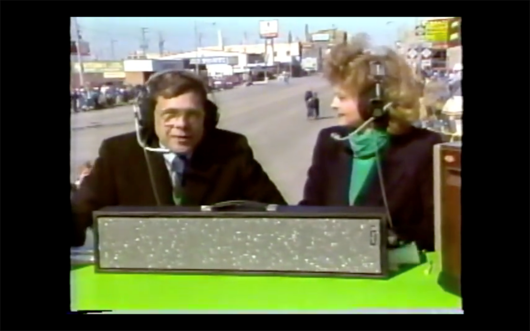 Dick Fabian anchors TV5's coverage of the 1987 St. Patrick's Day parade in Bay City. (Source: WNEM)