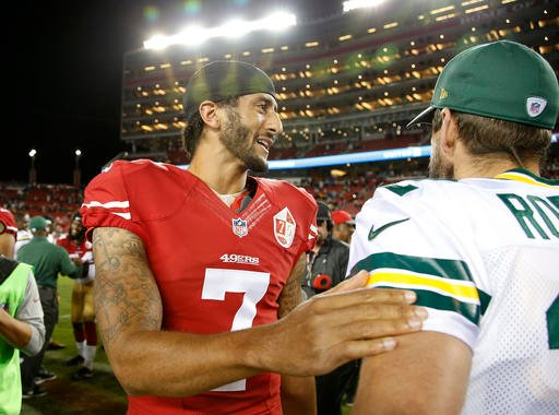 (AP Photo/Tony Avelar). San Francisco 49ers quarterback Colin Kaepernick, left, greets Green Bay Packers quarterback Aaron Rodgers at the end of an NFL preseason football game Friday, Aug. 26, 2016, in Santa Clara, Calif. Green Bay won 21-10.