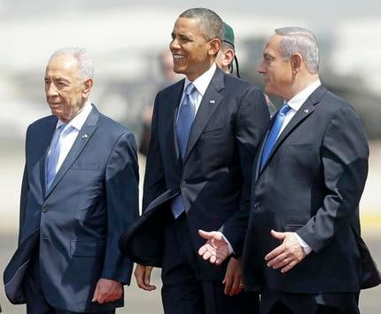 President Barack Obama is greeted by Israeli President Shimon Peres, left, and Israeli Prime Minister Benjamin Netanyahu upon his arrival ceremony at Ben Gurion International Airport in Tel Aviv, Israel in this file photo from March, 2013