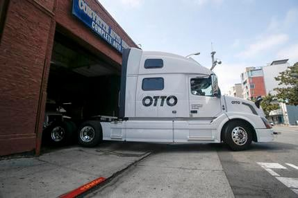 In this Aug. 18, 2016, file photo, one of Otto's self-driving, big-rig trucks leaves the garage for a test drive during a demonstration at the Otto headquarters in San Francisco. Anheuser-Busch announced on Oct. 25, 2016, that it teamed up with Otto for