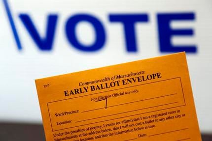 In this Oct. 24, 2016, photo, an early ballot envelope is held at town hall in North Andover, Mass. The millions of votes that have been cast already in the U.S. presidential election point to an advantage for Hillary Clinton in critical battleground stat