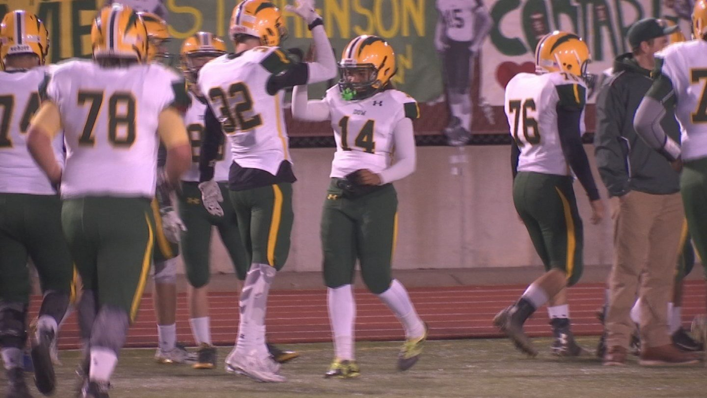 Ashton Brooks, No. 14, celebrates with teammates after scoring extra point during the playoff game against Bay City Central. (Source: WNEM)