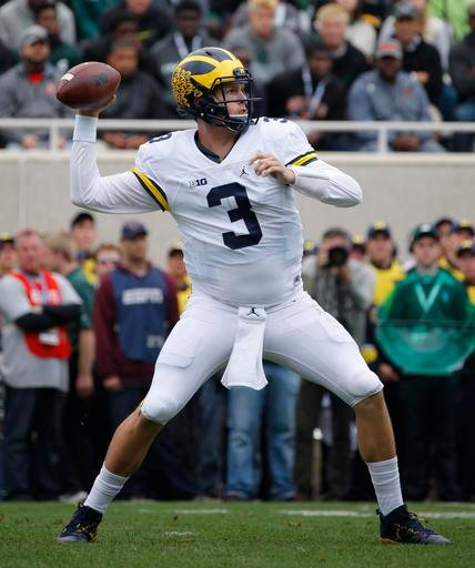 Michigan quarterback Wilton Speight throws a pass against Michigan State during the second quarter of an NCAA college football game, Saturday, Oct. 29, 2016, in East Lansing, Mich. (AP Photo/Al Goldis)