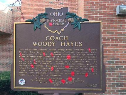 Red tape covers the Ms on the official state Ohio historical marker recognizing former Ohio State NCAA college football coach Woody Hayes at the Woody Hayes Football Center on the Ohio State University campus in Columbus, Ohio, Monday, Nov. 21, 2016. Ohio