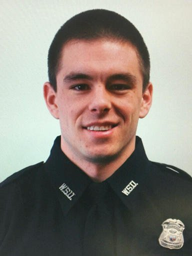 (Wayne State University via AP). This undated photo provided by Wayne State University shows university police officer Collin Rose, who was shot in the head while on patrol near a university campus in Detroit on Tuesday, Nov. 22, 2016.