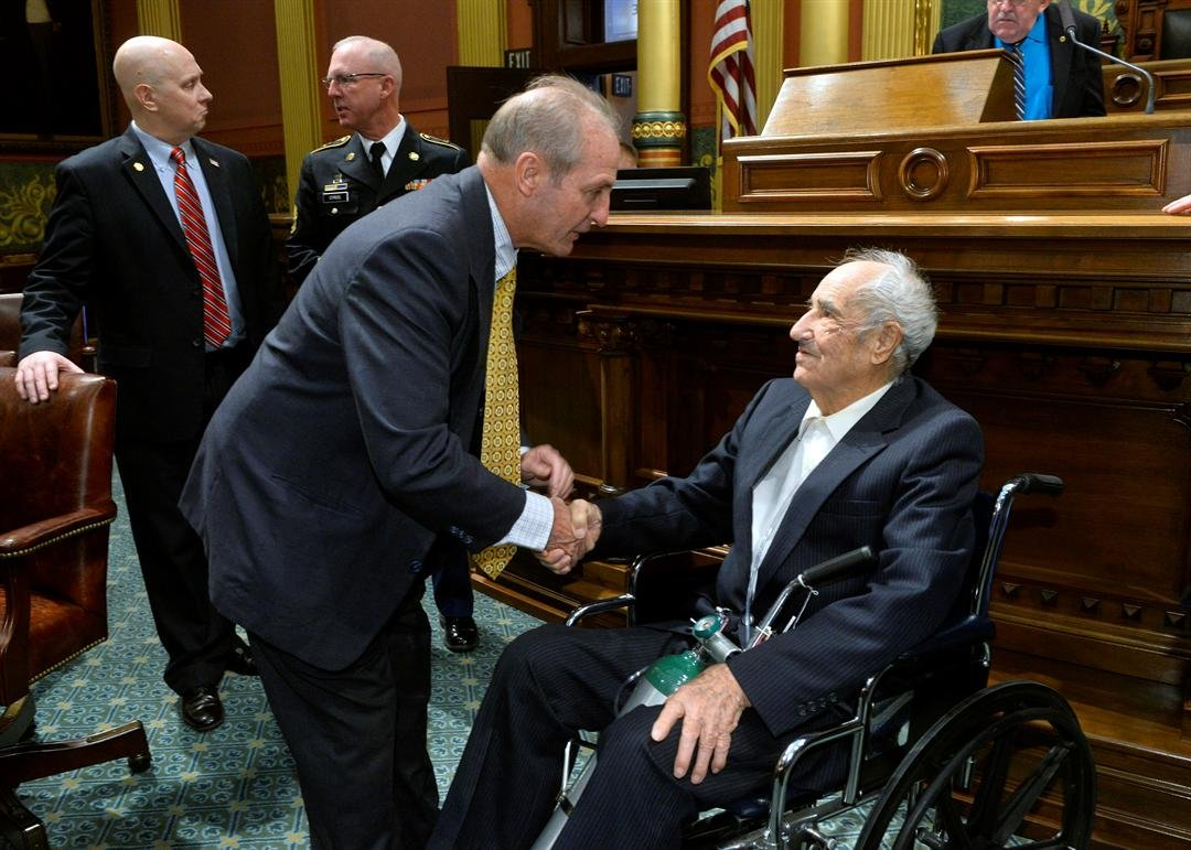 State Rep. Joseph Graves, R-Argentine Township, welcomes Pearl Harbor survivor Don Bloomfield, 95, of Midland, to the House floor.