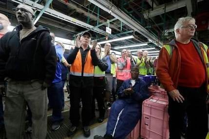 FILE - In this Tuesday, Jan. 3, 2017, file photo, Flat Rock Assembly employees clap as Ford President and CEO Mark Fields addresses the auto plant in Flat Rock, Mich.