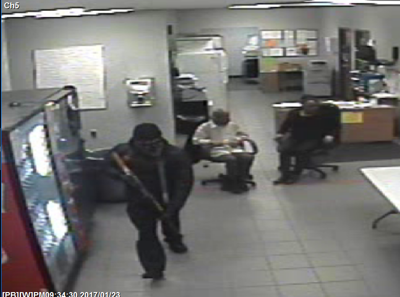 Surveillance photo of one of the suspects. (Source: MSP)