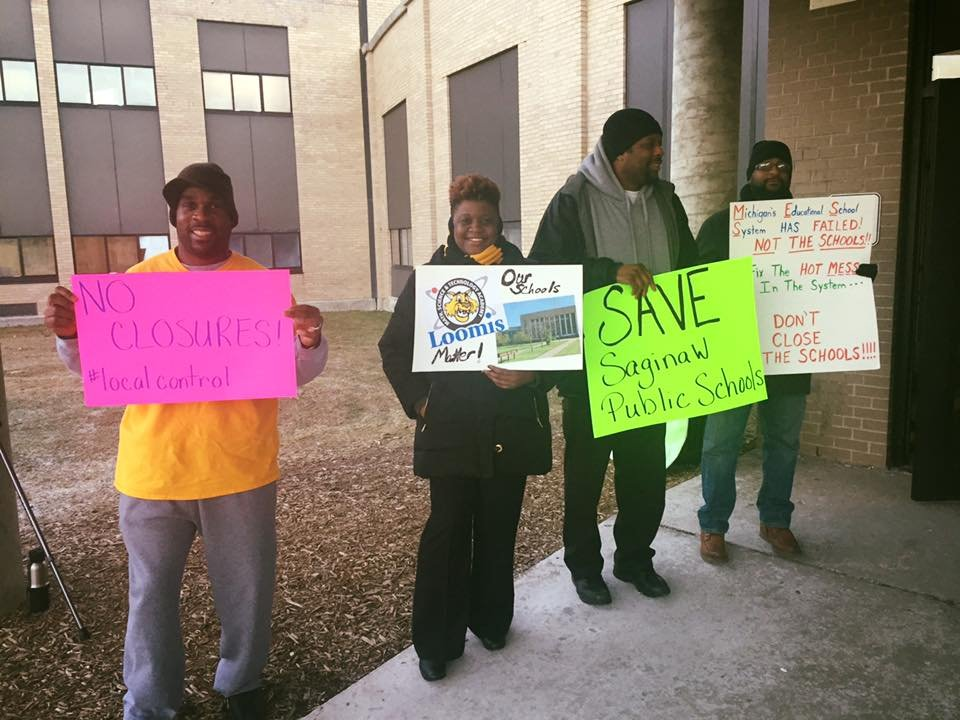 A group rallies in front of Saginaw High School to protest the possible state closure. (Photo provided)