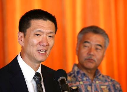 Hawaii attorney general Douglas Chin, left, along with Hawaii Gov. David Ige, speaks at a press conference Wednesday, March 15, 2017, in Honolulu.