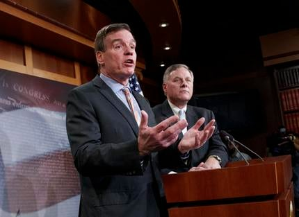 Senate Intelligence Committee Vice Chairman Sen. Mark Warner, D-Va., left, with Committee Chairman Sen. Richard Burr, R-N.C., speaks during a news conference on Capitol Hill in Washington