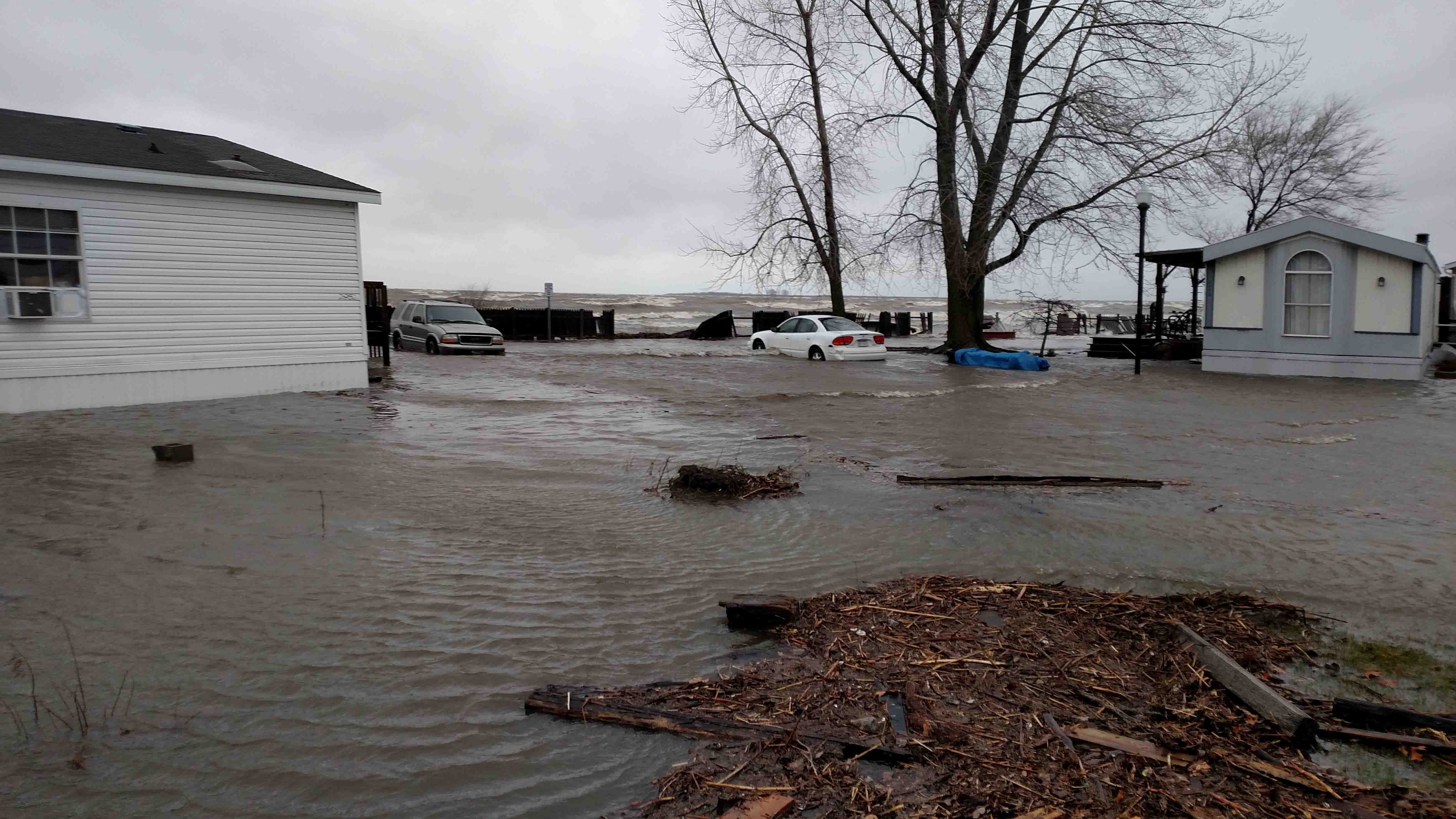 Heavy flooding at a Bay County mobile home park. Saginaw Bay visible in the background.