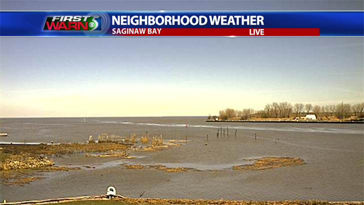 Brown water and debris still shown in the Saginaw Bay Saturday afternoon.