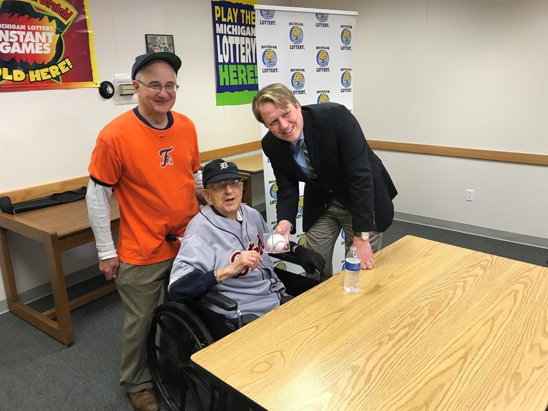 Lottery Commissioner, Aric Nesbitt, poses for a photo with Home Run Riches winner Stanley Jastrzembski and his son Mark Jastrzembski. (Source: Michigan Lottery)