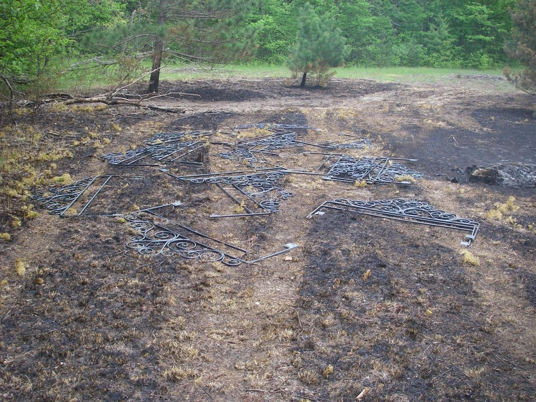: Several of the headboards found burned near the village of Lake Ann in Benzie County. (Source: DNR)