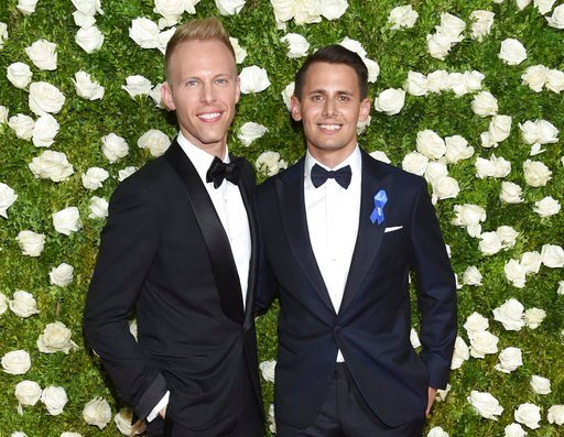 (Photo by Evan Agostini/Invision/AP). Justin Paul, left, and Benj Pasek arrive at the 71st annual Tony Awards at Radio City Music Hall on Sunday, June 11, 2017, in New York.