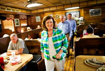 Karen Handel, Republican candidate for Georgia's 6th congressional district greets diners during a campaign stop at Old Hickory House in Tucker, Ga