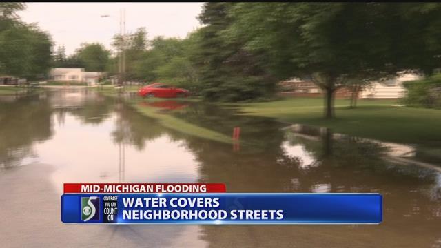 Water covers neighborhood streets