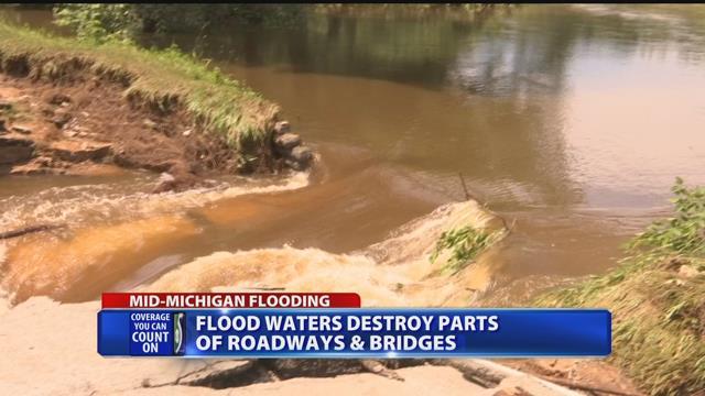 Flood water destroys parts of roadways, bridges