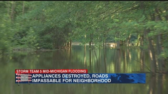 Residents cleaning up after historic flood