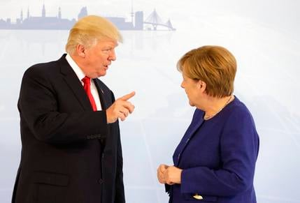 President Donald Trump and German Chancellor Angela Merkel pose for a photograph on the eve of the G-20 summit in Hamburg, Germany,