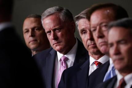 House Freedom Caucus Chairman Rep. Mark Meadows, R-N.C., second from left, and others, participates in a news conference on Capitol Hill in Washington, Wednesday, July 12, 2017, to say that his group wants to delay the traditional August recess until work