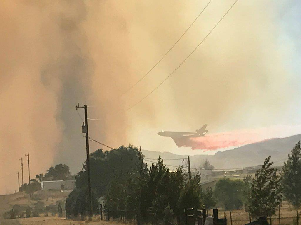 A plane releases fire-quenching chemicals on a wildfire near Nevada's Battle Mountain. Michigan Department of Natural Resources firefighters were among teams battling the grass and brush fire earlier this month. Photo courtesy Elko County Sheriff's Office