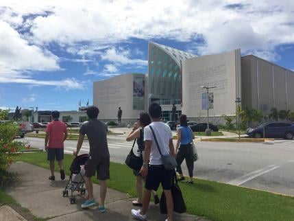 People walk around Hagatna, Guam Wednesday, Aug. 9, 2017. Despite government assurances, residents of the U.S. territory Guam say they're afraid after being caught in the middle of rising tensions between President Donald Trump and North Korea. (AP Photo/
