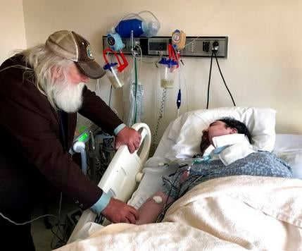Walter Wenger visits his severely disabled son, Steven, in a hospital in Kingston, N.Y, where he was moved after maggots were twice found in the area around his breathing tube while living in a state group home.