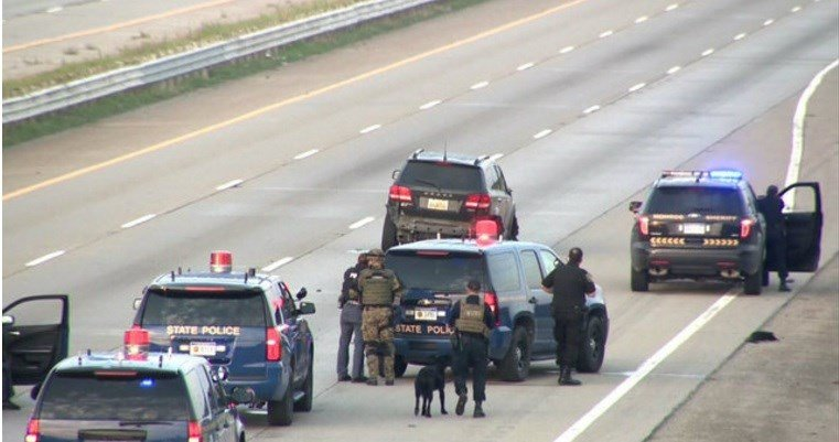 Man in custody after police chase, standoff shuts freeway