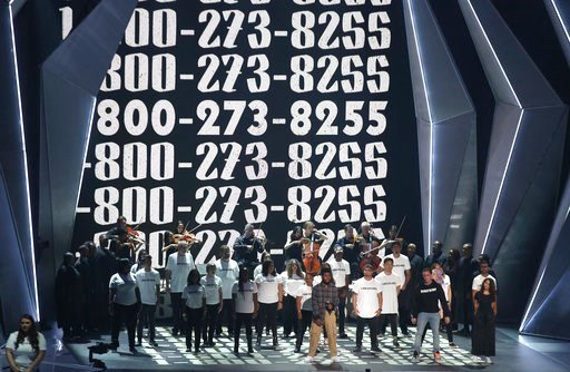 "(Photo by Matt Sayles/Invision/AP). Khalid, from left, Logic, and Alessia Cara perform ""1-800-273-8255"" at the MTV Video Music Awards at The Forum on Sunday, Aug. 27, 2017, in Inglewood, Calif."