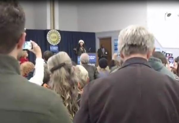 Cher speaks to a crowd in Flint on October 31, 2016.