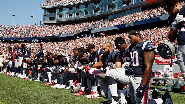Several New England Patriots players kneel during the national anthem before an NFL football game against the Houston Texans. (AP Photo/Michael Dwyer)
