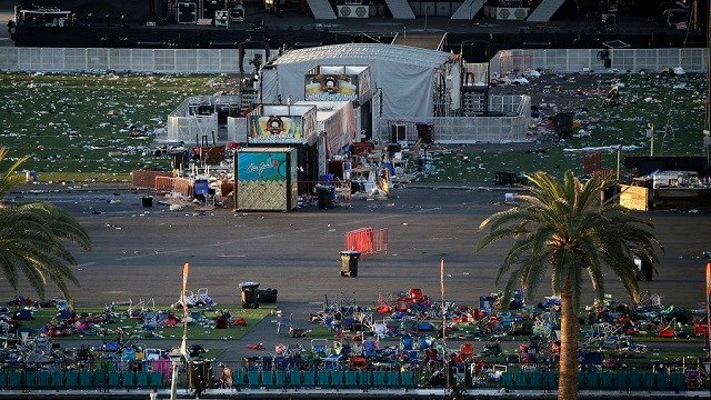Debris litters a festival grounds across the street from the Mandalay Bay resort and casino Tuesday, Oct. 3, 2017, in Las Vegas.  (AP Photo/John Locher)