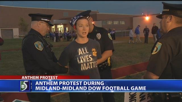 Video: Woman arrested at Midland football game during protests