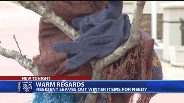 Video: Woman ties winter accessories on trees for those in need