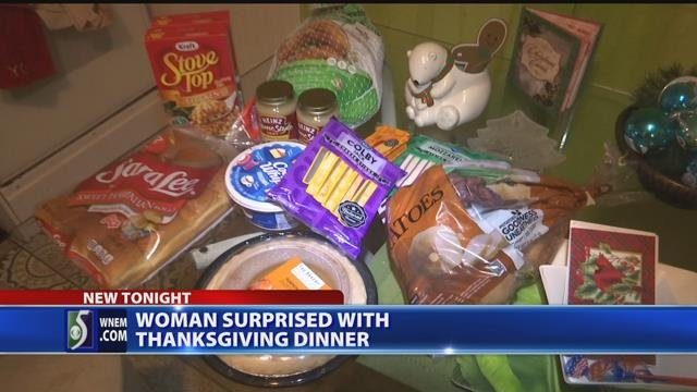 Video: Woman surprised with Thanksgiving dinner on porch