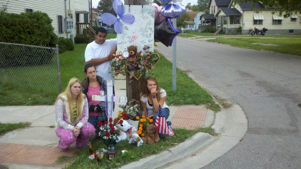 Friends gather to remember Misty Kurmas at the scene of the incident.