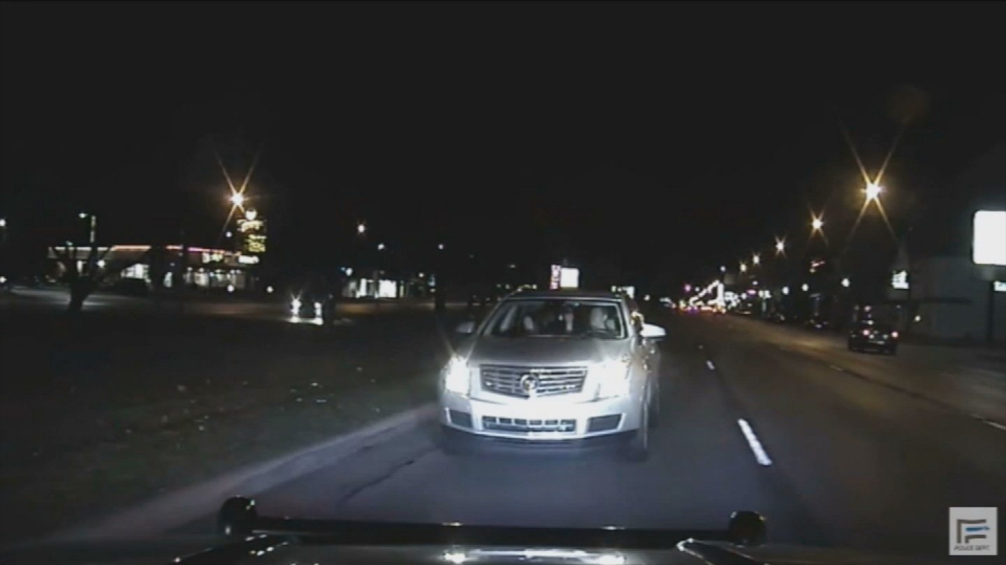 Dash cam video shows the officer was allegedly driving the wrong way on Woodward in Ferndale. (Source: CNN)