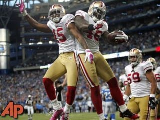 San Francisco 49ers tight end Delanie Walker (46) celebrates his fourth-quarter touchdown with wide receiver Michael Crabtree (15) to take the lead in an NFL football game against the Detroit Lions, Oct. 16, in Detroit. (AP Photo/Duane Burleson)