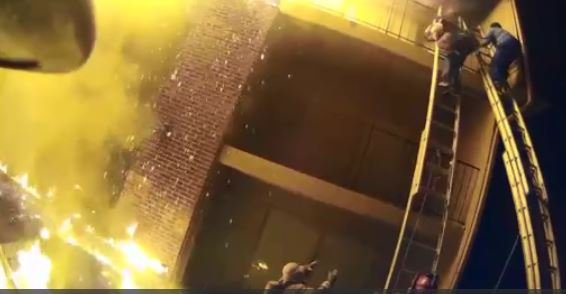 New footage emerges of firefighter saving baby thrown from balcony