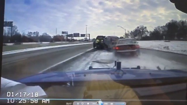 Auto slams into back of tow truck on on snow-covered freeway
