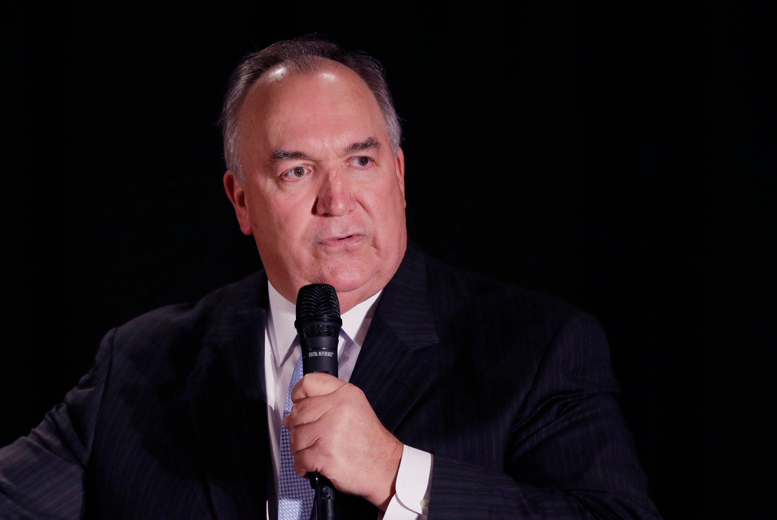 John Engler (In a photo from Oct. 13, 2014, former Michigan Gov. John Engler is seen during a Republican rally in Troy, Mich. (AP Photo/Carlos Osorio))