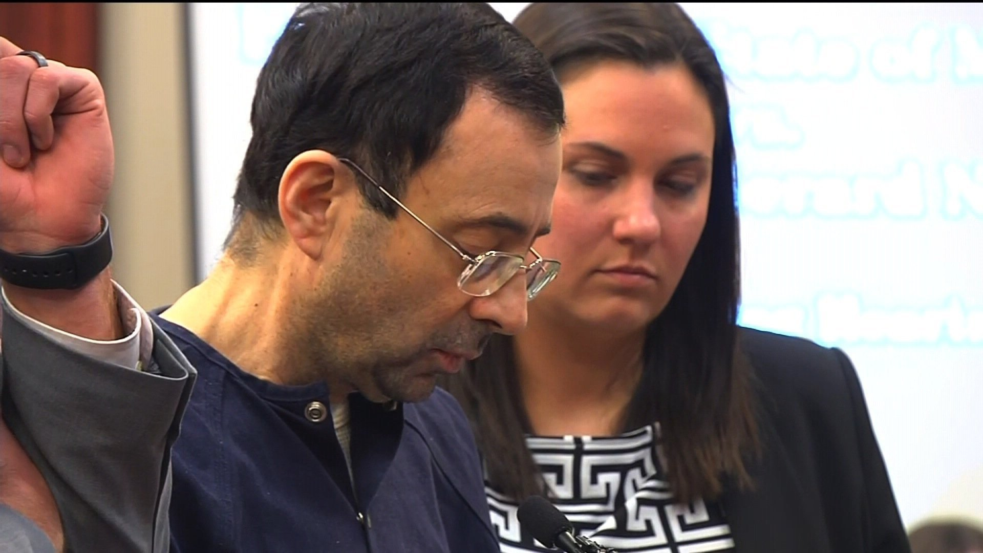 Victims' father lunges at Larry Nassar during hearing