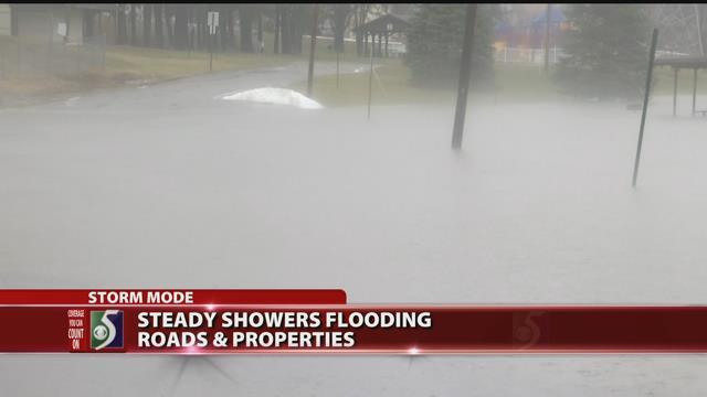 Steady showers flooding roads, properties