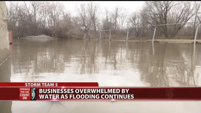 Businesses overwhelmed by water as flooding continues