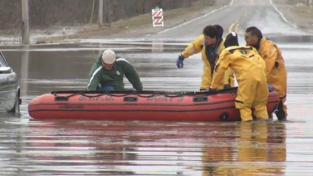 Video: Man rescued from car stalled in floodwaters