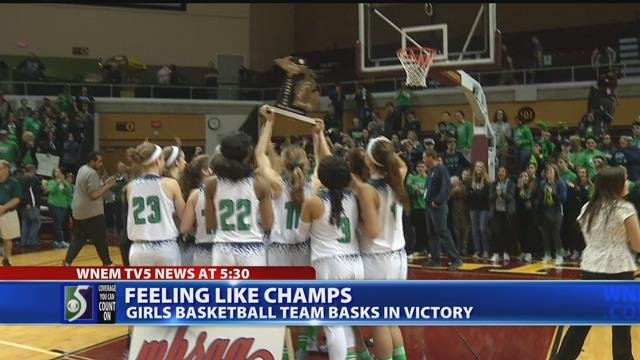 Video: Heritage High girl's basketball team return home as state champs