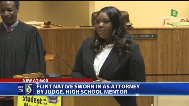 Flint native sworn in as attorney by judge, high school mentor