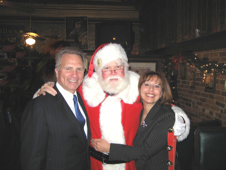 Genesee County Prosecutor David Leyton (left), Joel Florida (center) and Mrs. Leyton (right) (Courtesy: Genesee County Prosecutor John Potbury)